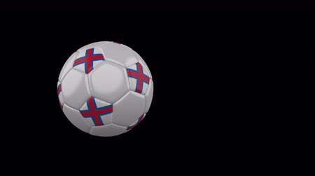 torshavn : Faroe Islands flag on a flying and rotating soccer ball on a transparent background, 4k prores footage with alpha channel Stock Footage