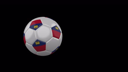 Liechtenstein flag on a flying and rotating soccer ball on a transparent background, 4k prores footage with alpha channel Стоковые видеозаписи