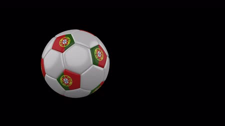 Portugal flag on a flying and rotating soccer ball on a transparent background, 4k prores footage with alpha channel