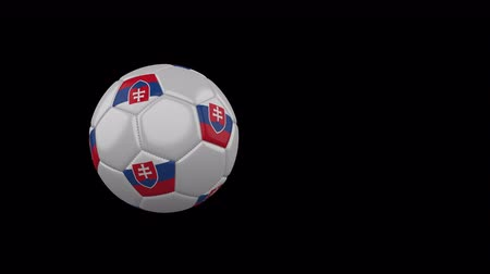 Словакия : Slovakia flag on a flying and rotating soccer ball on a transparent background, 4k prores footage with alpha channel