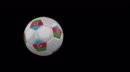 Azerbaijan flag on a flying and rotating soccer ball on a transparent background, 4k prores footage with alpha channel