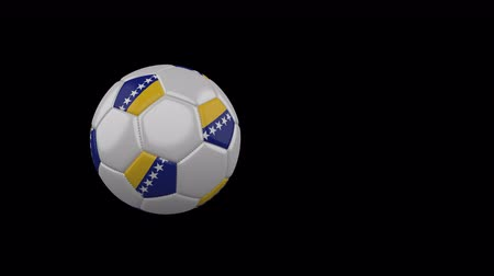cíle : Bosnia and Herzegovina flag on a flying and rotating soccer ball on a transparent background, 4k prores footage with alpha channel