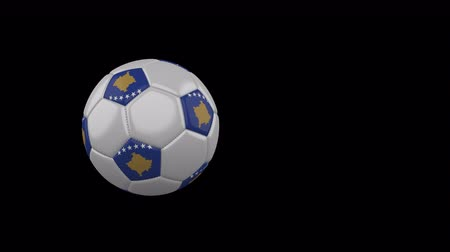 Kosovo flag on a flying and rotating soccer ball on a transparent background, 4k prores footage with alpha channel Стоковые видеозаписи