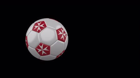 rotates : Malta flag on a flying and rotating soccer ball on a transparent background, 4k prores footage with alpha channel