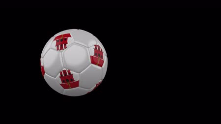 Gibraltar flag on a flying and rotating soccer ball on a transparent background, 4k prores footage with alpha channel