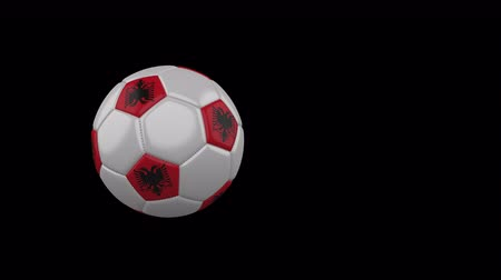 Albania flag on a flying and rotating soccer ball on a transparent background, 4k prores footage with alpha channel