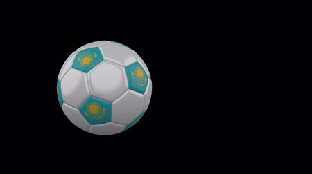 astana : Kazakhstan flag on a flying and rotating soccer ball on a transparent background, 4k prores footage with alpha channel