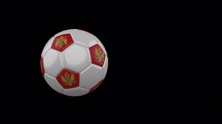 Montenegro flag on a flying and rotating soccer ball on a transparent background, 4k prores footage with alpha channel
