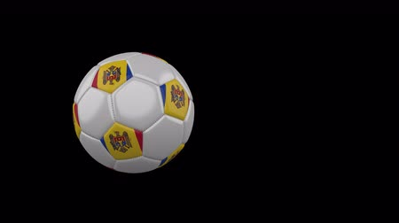 Moldova flag on a flying and rotating soccer ball on a transparent background, 4k prores footage with alpha channel