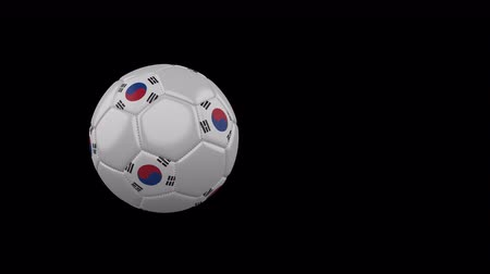 South Korea flag on a flying and rotating soccer ball on a transparent background, 4k prores footage with alpha channel