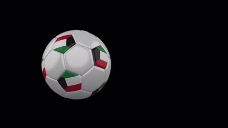 Kuwait flag on a flying and rotating soccer ball on a transparent background, 4k prores footage with alpha channel Стоковые видеозаписи
