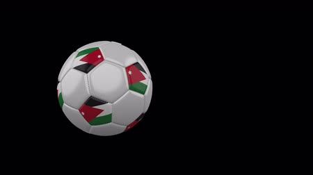 Jordan flag on a flying and rotating soccer ball on a transparent background, 4k prores footage with alpha channel