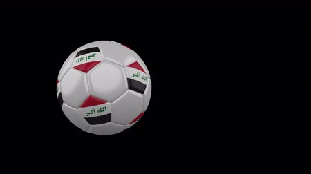 Iraq flag on a flying and rotating soccer ball on a transparent background, 4k prores footage with alpha channel