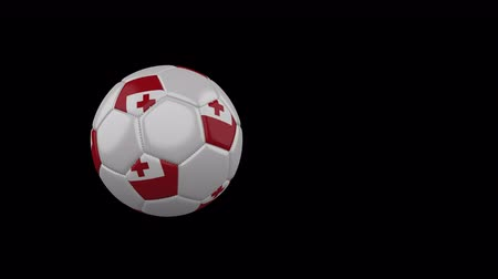 Tonga flag on a flying and rotating soccer ball on a transparent background, 4k prores footage with alpha channel Стоковые видеозаписи