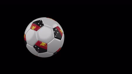 monarchy : Papua New Guinea flag on a flying and rotating soccer ball on a transparent background, 4k prores footage with alpha channel