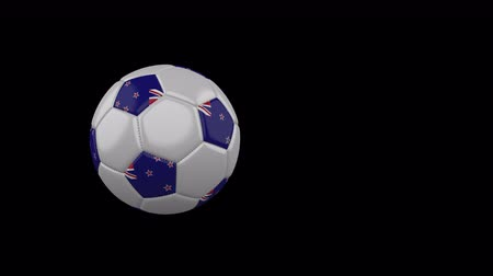 New Zealand flag on a flying and rotating soccer ball on a transparent background, 4k prores footage with alpha channel