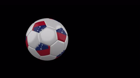 Samoa flag on a flying and rotating soccer ball on a transparent background, 4k prores footage with alpha channel Стоковые видеозаписи