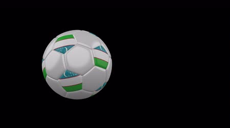Uzbekistan flag on a flying and rotating soccer ball on a transparent background, 4k prores footage with alpha channel