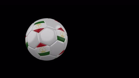 Tajikistan flag on a flying and rotating soccer ball on a transparent background, 4k prores footage with alpha channel