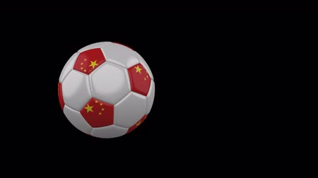 China flag on a flying and rotating soccer ball on a transparent background, 4k prores footage with alpha channel Стоковые видеозаписи