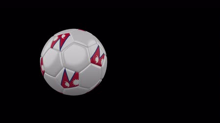 Nepal flag on a flying and rotating soccer ball on a transparent background, 4k prores footage with alpha channel Стоковые видеозаписи