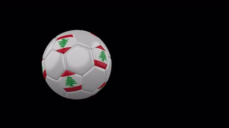 Lebanon flag on a flying and rotating soccer ball on a transparent background, 4k prores footage with alpha channel