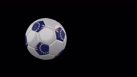 Cook Islands flag on a flying and rotating soccer ball on a transparent background, 4k prores footage with alpha channel