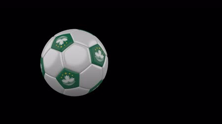 Macao flag on a flying and rotating soccer ball on a transparent background, 4k prores footage with alpha channel