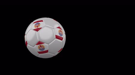 French Polynesia flag on a flying and rotating soccer ball on a transparent background, 4k prores footage with alpha channel