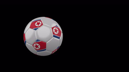 democrático : North Korea flag on a flying and rotating soccer ball on a transparent background, 4k prores footage with alpha channel