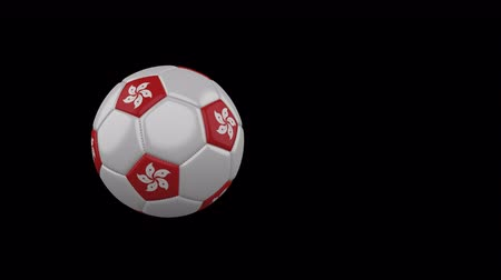 Hong Kong flag on a flying and rotating soccer ball on a transparent background, 4k prores footage with alpha channel