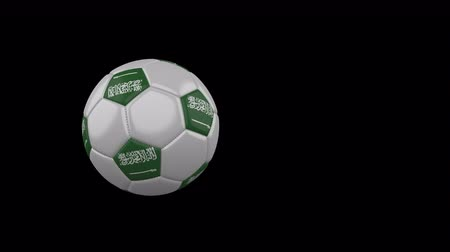 Saudi Arabia flag on a flying and rotating soccer ball on a transparent background, 4k prores footage with alpha channel Стоковые видеозаписи
