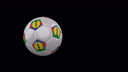 New Caledonia flag on a flying and rotating soccer ball on a transparent background, 4k prores footage with alpha channel Стоковые видеозаписи