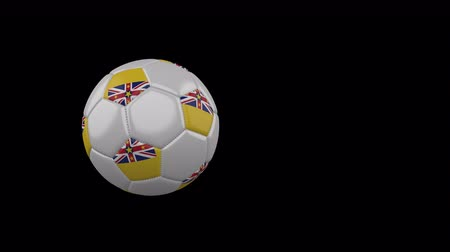 Niue flag on a flying and rotating soccer ball on a transparent background, 4k prores footage with alpha channel Стоковые видеозаписи