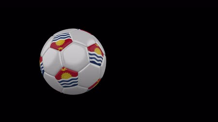 Kiribati flag on a flying and rotating soccer ball on a transparent background, 4k prores footage with alpha channel