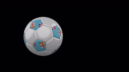 suva : Republic of Fiji flag on a flying and rotating soccer ball on a transparent background, 4k prores footage with alpha channel
