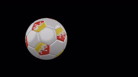 bhutan : Bhutan flag on a flying and rotating soccer ball on a transparent background, 4k prores footage with alpha channel