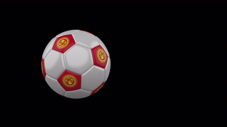 Kyrgyzstan flag on a flying and rotating soccer ball on a transparent background, 4k prores footage with alpha channel