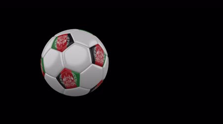 afghan : Afghanistan flag on a flying and rotating soccer ball on a transparent background, 4k prores footage with alpha channel