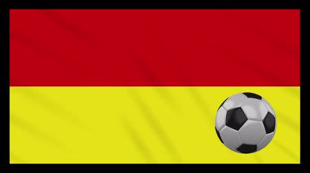 Tamil Eelam bicolor flag and soccer ball rotates against background of a waving cloth, loop Стоковые видеозаписи