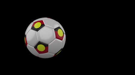 Australian Aboriginal - Mariya flag on a flying and rotating soccer ball on a transparent background, 4k prores footage with alpha channel