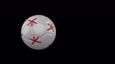 Parishes of Jersey flag on a flying and rotating soccer ball on a transparent background, 4k prores footage with alpha channel Стоковые видеозаписи