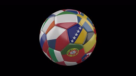 hırvatistan : Flags of Europe on soccer ball rotating on transparent background, 4k footage with alpha channel, loop Stok Video