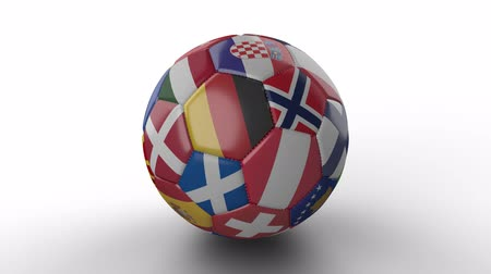 irsko : Soccer ball with flags of European countries rotates and casts shadow on white surface, loop 2