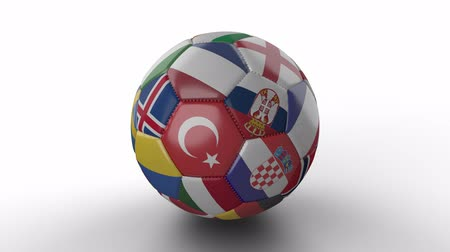 hırvatistan : Soccer ball with flags of European countries rotates and casts shadow on white surface, loop 3 Stok Video