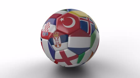 hırvatistan : Soccer ball with flags of European countries rotates and casts shadow on white surface, loop