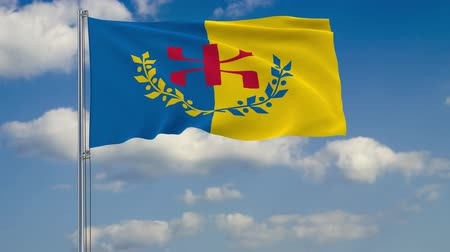 Flag of Kabylia against background of clouds floating on the blue sky