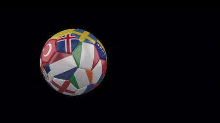 Flags of Euro 3 on slow flying and rotating soccer ball on a transparent background, 4k prores footage with alpha channel