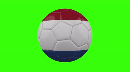 futball labda : Netherlands flag on a ball rotates on a transparent green background, 4k prores footage with alpha transparency, loop