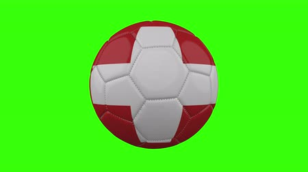 futball labda : Switzerland flag on a ball rotates on a transparent green background, 4k prores footage with alpha transparency, loop